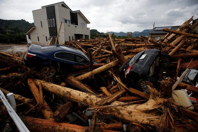 Debris and cars which were swept by heavy rain are seen in Asakura, Fukuoka Prefecture, Japan July 8, 2017. (Photo by Issei Kato/Reuters)