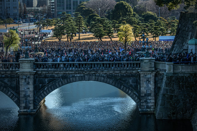 Well-wishers queue to enter the Imperial Palace ahead of a New Year's greeting by Emperor Naruhito of Japan on January 2, 2020 in Tokyo, Japan. (Photo by Carl Court/Getty Images)