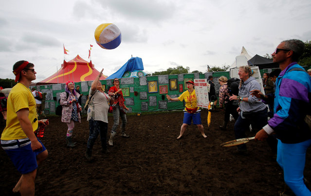 Revellers play with a ball at Worthy Farm in Somerset during the Glastonbury Festival, Britain, June 26, 2016. (Photo by Stoyan Nenov/Reuters)