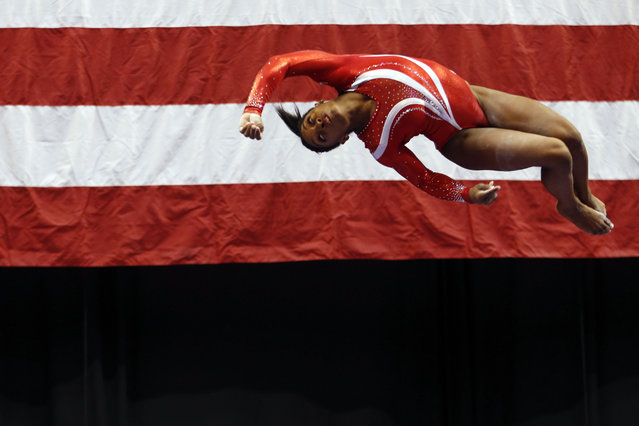 Simone Biles competes on the balance beam at the U.S. women's gymnastic championships Saturday, August 15, 2015, in Indianapolis. (Photo by A. J. Mast/AP Photo)