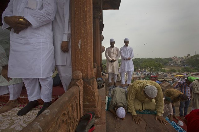Muslims offer prayers on the last Friday of the holy month of Ramadan at the Jama Maszid or Mosque in New Delhi, India, Friday, July 1, 2016. Muslims throughout the world are marking the month of Ramadan, the holiest month on the Islamic calendar, by fasting from dawn till dusk. (Photo by Manish Swarup/AP Photo)