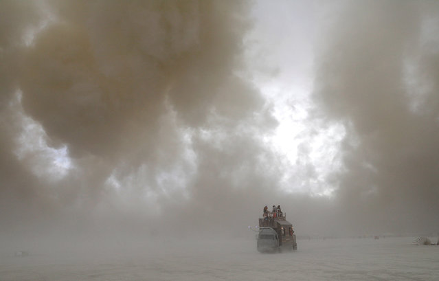 "The Burning Man art car ""Snailoon"" drives through a desert dust storm on the 2nd day of the annual Burning Man arts and music festival in the Black Rock Desert of Nevada, U.S. August 29, 2017. (Photo by Jim Urquhart/Reuters)"