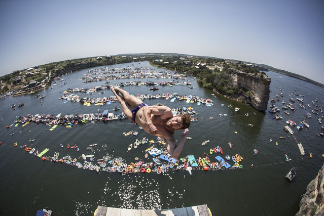 In this handout image provided by Red Bull, David Colturi of the USA dives from the 27 metre platform during the fourth stop of the Red Bull Cliff Diving World Series on September 3, 2017 in Possum Kingdom Lake, Texas, USA. (Photo by Romina Amato/Red Bull via Getty Images)