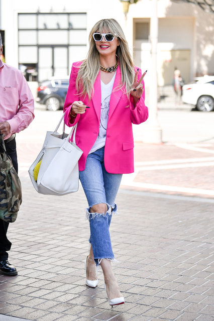 """Heidi Klum was seen arriving to """"America's Got Talent"""" on March 8, 2020 in a blindly bright hot pink blazer. (Photo by PG/The Mega Agency)"""