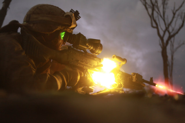 Pfc. Sebastian Rodriguez, machine gunner, Weapons Platoon, Lima Company, 3rd Battalion, 3rd Marine Regiment, Marine Rotational Force – Darwin, fires an M240 machine gun during a night squad-attack exercise, here, May 22, 2013. (Photo by Sgt. Sarah Fiocco/U.S. Marines)