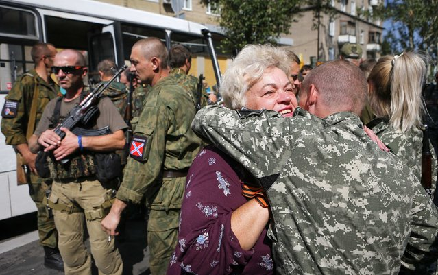 A woman pro-Russian supporter greets one of the rebels after a rally in Donetsk August 24, 2014. (Photo by Maxim Shemetov/Reuters)