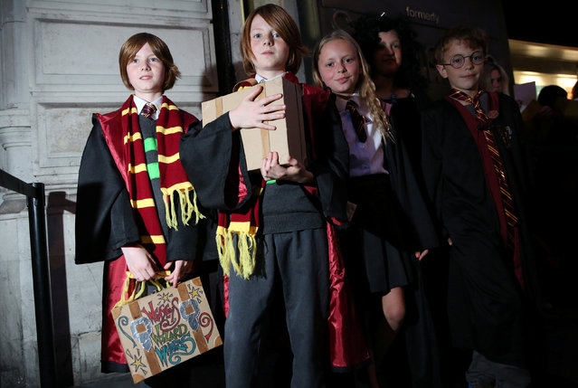 Fans queue at an event to mark the release of the book of the play of Harry Potter and the Cursed Child parts One and Two at a bookstore in London, Britain July 30, 2016. (Photo by Neil Hall/Reuters)