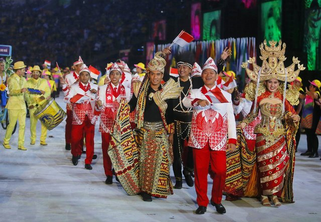 Athletes of Indonesia walk into the Maracana Stadium during the Opening Ceremony of the Rio 2016 Olympic Games in Rio de Janeiro, Brazil, 05 August 2016. (Photo by Sergey Ilnitsky/EPA)