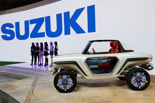 Models present Suzuki Motor's EV e-Survivor concept during media preview of the 45th Tokyo Motor Show in Tokyo, Japan on October 25, 2017. (Photo by Kim Kyung-Hoon/Reuters)