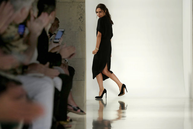 Designer Victoria Beckham acknowledges audience applause  after her Spring 2016 collection was modeled during Fashion Week in New York, Sunday, September 13, 2015. (Photo by Richard Drew/AP Photo)
