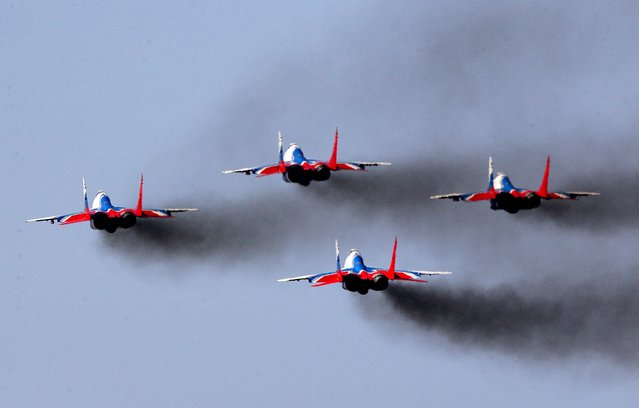 Mikoyan MiG-29UB fighter jets of the Strizhi (Swifts) aerobatic team fly in formation during a rehearsal of a military parade marking the 75th anniversary of the victory over Nazi Germany in World War II in Alabino, Moscow Region, Russia on June 10, 2020. Russian President Vladimir Putin has postponed the Victory Day parade to June 24 due to the COVID-19 coronavirus pandemic. (Photo by Sergei Bobylev/TASS)