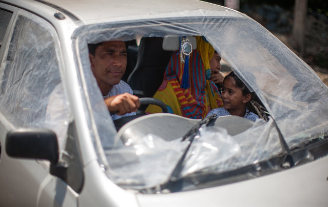 A Kashmir Muslim family negotiates a curfew in a car covered with plastic sheets after its window panes were broken in clashes between Indian government forces and Kashmiri Muslims, following weeks of violence that has left over 67 people dead and thousands injured on August 21, 2016 in Srinagar, the summer capital of Indian administered Kashmir, India. Indian authorities have sealed all the streets and roads in Kashmir to impose strict curfew on the 44th day and to thwart anti Indian and pro Kashmir freedom protest marches, which aims to protest against the killing of innocents in the valley. Currently 67 died and over 6,000 have been injured during the fierce protests over the killing of a young rebel commander Burhan Wani. The violence in the area is the worst since 2010 and the protests have triggered a heavy crackdown by Indian government forces which include many strict curfews. (Photo by Yawar Nazir/Getty Images)