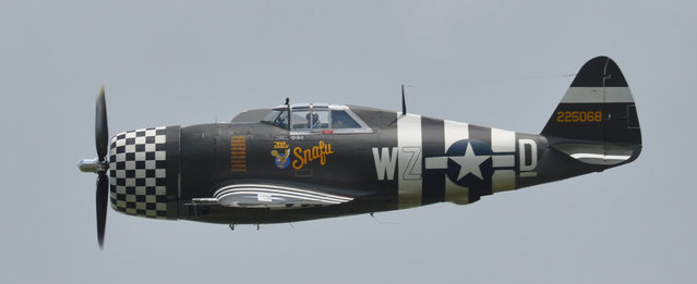 """Republic P-47G Thunderbolt 42-25068 """"Snafu"""" G-CDVX (WZ-D) – The Fighter Collection – Flying Legends Airshow Duxford 2012. The Fighter Collection """"Razorback"""" P-47G is one of only two Curtiss-built examples left in the world. She was the 129th P-47G built at the Curtiss facility in Buffalo, New York in early 1944. The fighter was accepted by the USAAF in September 1944 and transferred to the Third Air Force at Tallahassee, Florida. It was here that she was re-designated as a TP-47G to reflect the training role she undertook with a number of Advanced Fighter Transition Units. The Fighter Collection P-47G was struck from the USAAF inventory in late June 1945 and was eventually passed to the Aero Industries Technical Institute at Oakland Airport, California. It was here that she taught hydraulic and electrical systems to aeronautical students until 1952 when she was bought by Jack Hardwick, a former Cleveland National Air Race pilot, who rented her out in 1953 to Allied Artists for ground scenes in the film Fighter Attack. (Rob Lovesey)"""