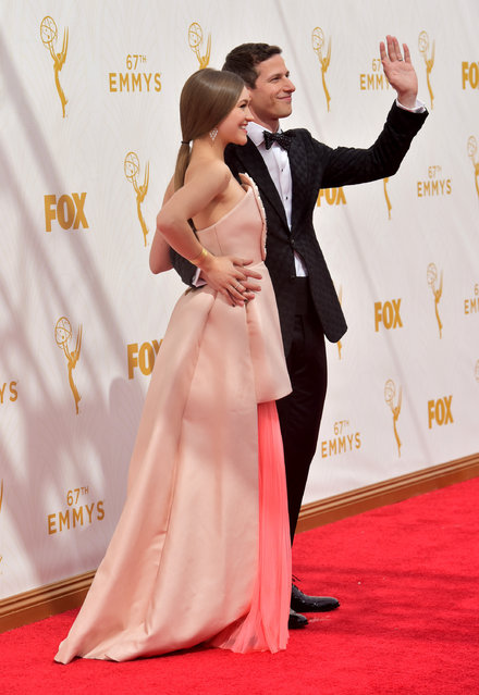Joanna Newsom, left, and Andy Samberg arrive at the 67th Primetime Emmy Awards on Sunday, September 20, 2015, at the Microsoft Theater in Los Angeles. (Photo by Charles Sykes/Invision for the Television Academy/AP Images)