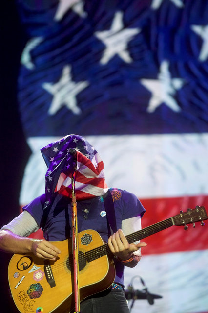 An American flag covers Chris Martin's face as he performs with other members of Coldplay during the fifth annual Made in America Music Festival in Philadelphia, Pennsylvania, U.S. September 4, 2016. (Photo by Mark Makela/Reuters)