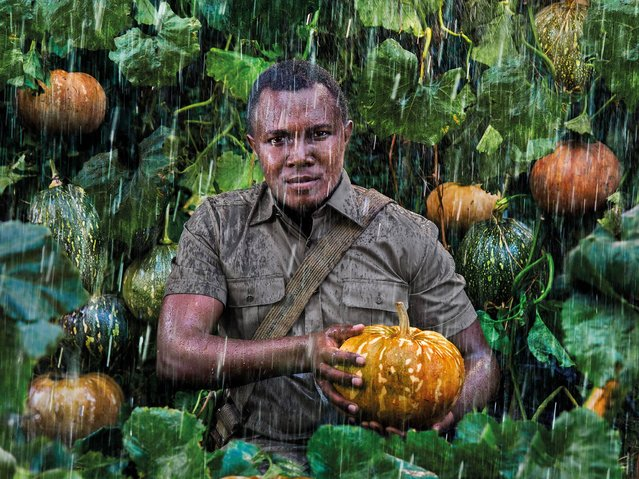 """""""Seed Saver"""". John Kariuki Mwangi, Slow Food Foundation for Biodiversity Vice President and the coordinator of all operations in Kenya, he is 27 years old and stands guard over the pumpkins of Lare, which have been thriving in the area for centuries despite the highly irregular rainfall. (Photo by Steve McCurry/2015 Lavazza Calendar)"""