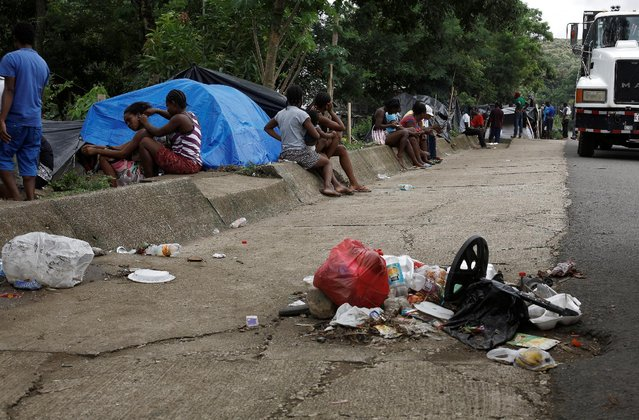 Africans migrants stranded in Costa Rica sit near garbage on the Inter-American highway in the border between Costa Rica and Nicaragua, in Penas Blancas, Costa Rica, September 7, 2016. (Photo by Juan Carlos Ulate/Reuters)
