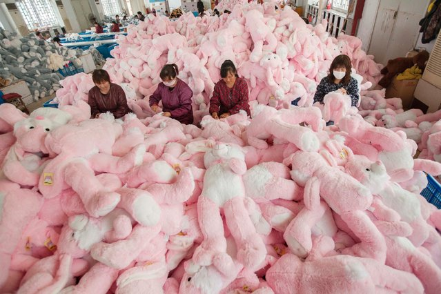 Employees manufacture toys at a workshop, October 30, 2014 in Lianyungang, China. Hundreds of toy companies usher in peak period of production and sales and prepare to exports their products to over 60 countries as the new year draws near. (Photo by ChinaFotoPress via Getty Images)