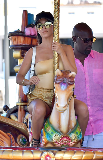 Kourtney Kardashian enjoys a carousel ride with her daughter Penelope Disick, Kris Jenner and Corey Gamble while on holiday in Saint-Tropez, France on September 6, 2016. (Photo by E-Press/XposurePhotos.com)