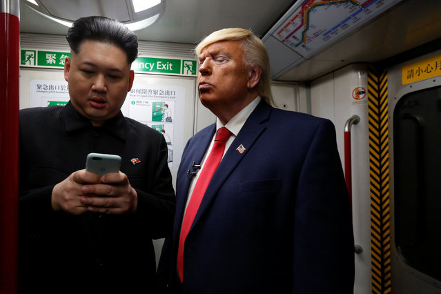 Howard, 37, an Australian-Chinese who is impersonating North Korean leader Kim Jong-un, and Dennis Alan of Chicago, 66, who is impersonating U.S. President Donald Trump, ride a subway train in Hong Kong, China January 25, 2017. (Photo by Bobby Yip/Reuters)