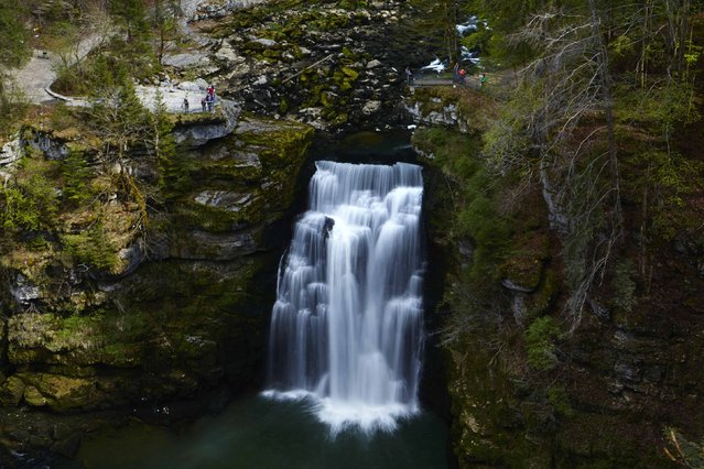 The Saut du Doubs waterfall is seen on the border between Switzerland (L) and France in Villers-le-Lac April 23, 2014. (Photo by Denis Balibouse/Reuters)