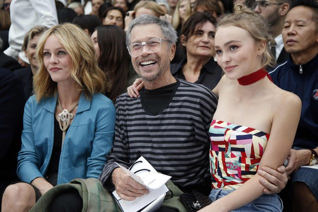 French singer Vanessa Paradis (L), her daughter Lily-Rose Depp (R) and French artist Jean-Paul Goude (C) attend the Spring/Summer 2016 women's ready-to-wear collection for fashion house Chanel at the Grand Palais which is transformed into a Chanel airport during the Fashion Week in Paris, France, October 6, 2015. (Photo by Charles Platiau/Reuters)
