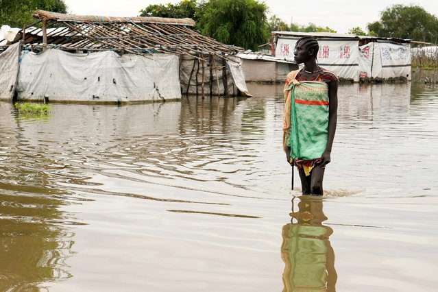 A girl walks in water in the town of Pibor, Boma state, South Sudan, November 6, 2019. (Photo by Andreea Campeanu/Reuters)