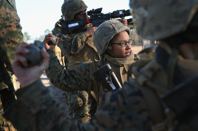 Pvt. Gina Rodriguez prepares to throw a practice grenade during Marine Combat Training (MCT) on February 21, 2013 at Camp Lejeune, North Carolina.  Since 1988 all non-infantry enlisted male Marines have been required to complete 29 days of basic combat skills training at MCT after graduating from boot camp. MCT has been required for all enlisted female Marines since 1997. About six percent of enlisted Marines are female.  (Photo by Scott Olson)