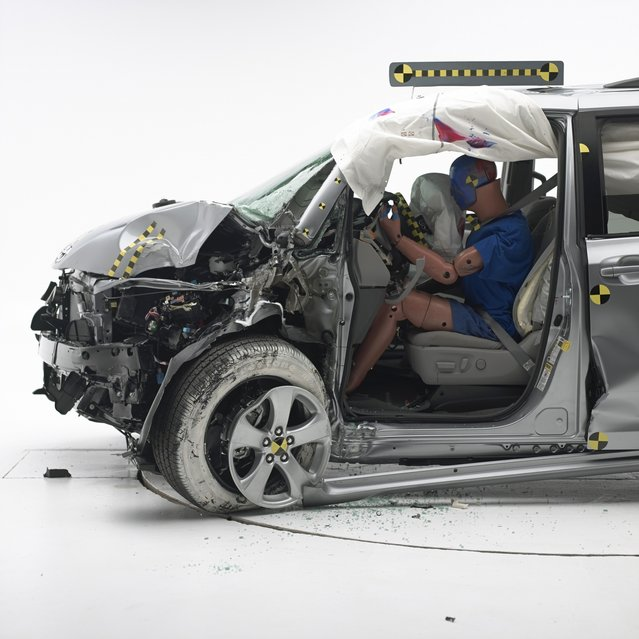 "In an undated handout photo, a 2015 Toyota Sienna minivan after a ""small overlap"" front crash test by the Insurance Institute for Highway Safety, which gave the vehicle an acceptable rating. The  institute said on November 19, 2014, that three other minivans had failed its ""small overlap"" front crash test, with one van experiencing the deepest intrusion into the passenger compartment of any vehicle ever evaluated in the test. (Photo by Insurance Institute for Highway Safety via The New York Times)"