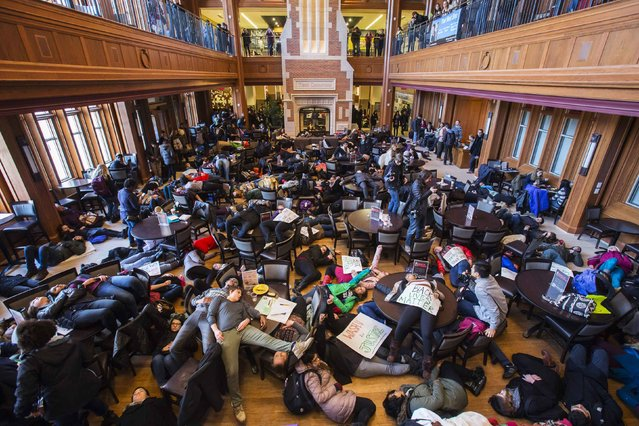 "Student activists stage a ""die-in"" as part of the nationwide ""Hands up, walk out"" protest, demanding justice for the fatal August 9 shooting of 18-year-old Michael Brown, at Washington University in St. Louis December 1, 2014. (Photo by Adrees Latif/Reuters)"