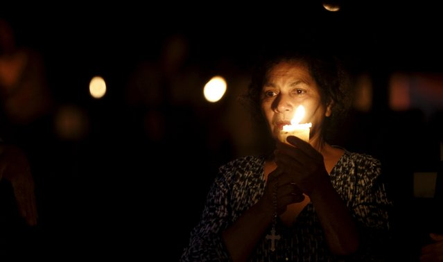 A woman prays as she takes part in a vigil at a cemetery in Barva de Heredia, Costa Rica October 31, 2015. (Photo by Juan Carlos Ulate/Reuters)