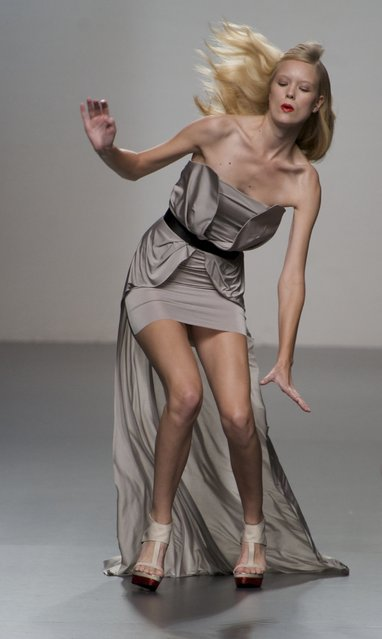 A model stumbles walking the runway in the Amaya Arzuaga fashion show during the Cibeles Madrid Fashion Week Spring/Summer 2012at Ifema on September 18, 2011 in Madrid, Spain. (Photo by Juan Naharro Gimenez/Getty Images)