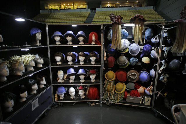 "Wigs and hats of the artists of the Cirque du Soleil rest on a big boxes used as wardrobes backstage ahead of the show ""Quidam"" during a photo opportunity for the media at the Meo Arena pavilion in Lisbon, Portugal Thursday, December 18, 2014. (Photo by Francisco Seco/AP Photo)"