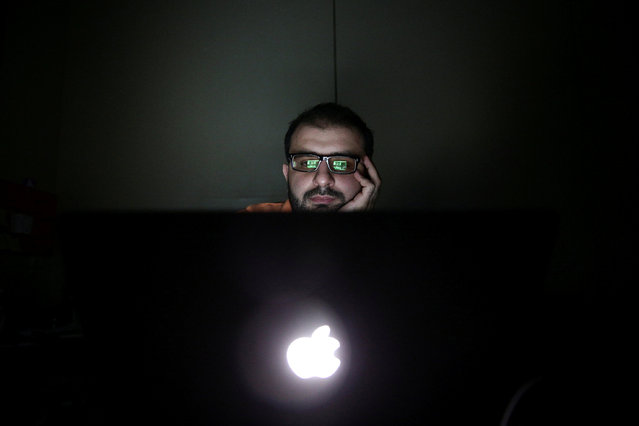 Director Humam Husari edits his film after finishing the filming phase at his office in the rebel held Douma neighbourhood of Damascus, Syria October 5, 2016. (Photo by Bassam Khabieh/Reuters)
