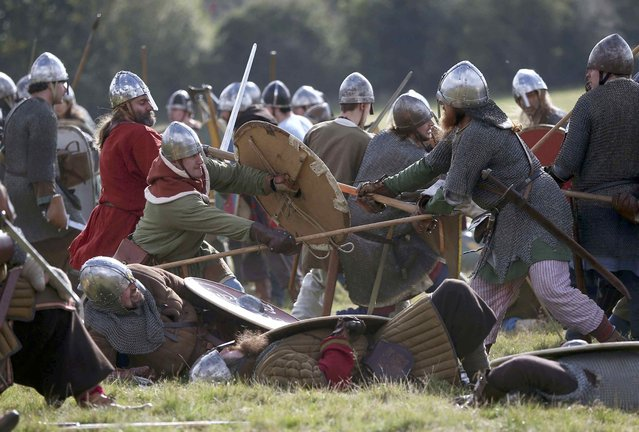 Participants fight during a re-enactment of the the Battle of Hastings on the 950th anniversary of the battle, in Battle, Britain October 15, 2016. (Photo by Neil Hall/Reuters)