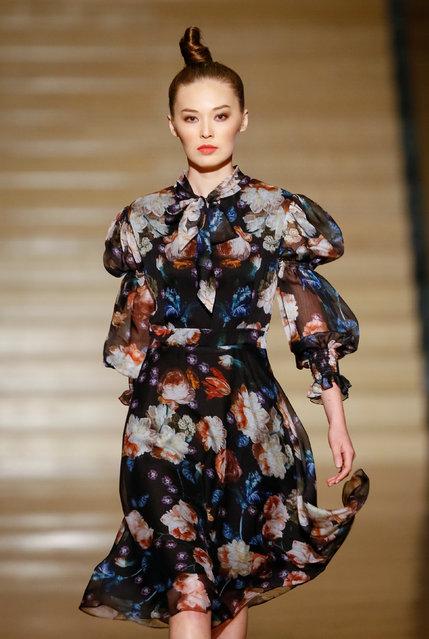 A model presents a creation by Kazakhstan's designer Dinara Satzhan during Kazakhstan Fashion Week at National Academical Theater of Opera and Ballet in Almaty, Kazakhstan April 11, 2018. (Photo by Shamil Zhumatov/Reuters)