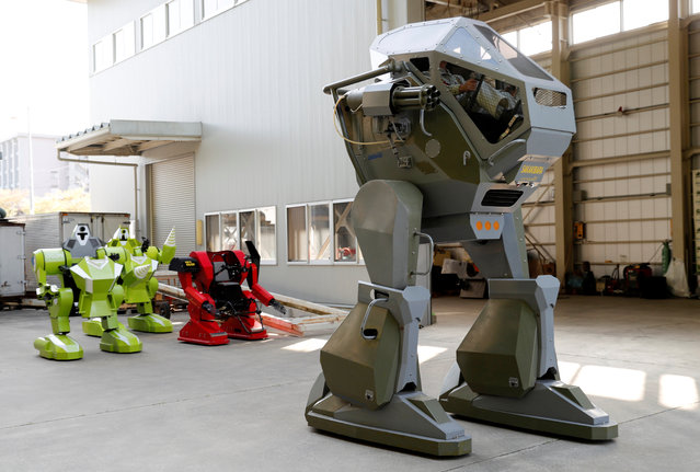 Sakakibara Kikai's engineer Masaaki Nagumo controls the bipedal robot Land Walker during its demonstration at its factory in Shinto Village, Gunma Prefecture, Japan on April 12, 2018. (Photo by Kim Kyung-Hoon/Reuters)