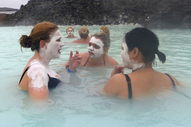 Visitors enjoy a drink in the Blue Lagoon geothermal spa in Grindavik, Iceland, May 25, 2016. (Photo by Gwladys Fouche/Reuters)