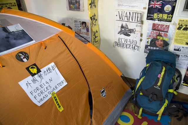 A traveller's backpack is seen next to a tent at a guesthouse in Hong Kong December 30, 2014. (Photo by Tyrone Siu/Reuters)