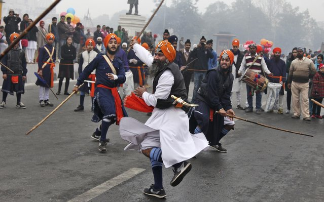 Indian Sikh warriors display traditional martial art skills during a religious procession ahead of the birth anniversary of Guru Gobind Singh in Jammu, India, Monday, January 5, 2015. (Photo by Channi Anand/AP Photo)