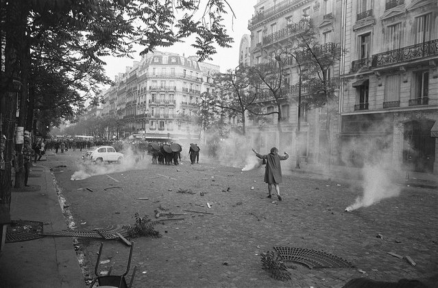On the first day of violence during student riots, a young woman challenges shield-bearing CRS police in a cloud of tear gas at Place Mabillon on Boulevard Saint-Germain, France, Paris,  May 6, 1968. (Photo by Gökşin Sipahioğlu/SIPA Press)