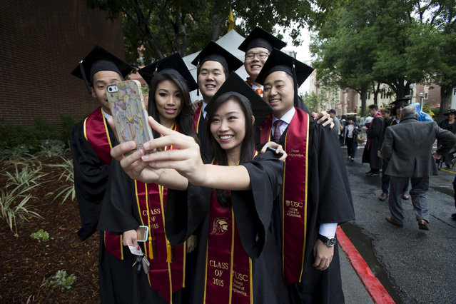 Graduating students take a selfie following USC's Commencement Ceremony at the University of Southern California in Los Angeles, California, U.S. on May 15, 2015. (Photo by Mario Anzuoni/Reuters)