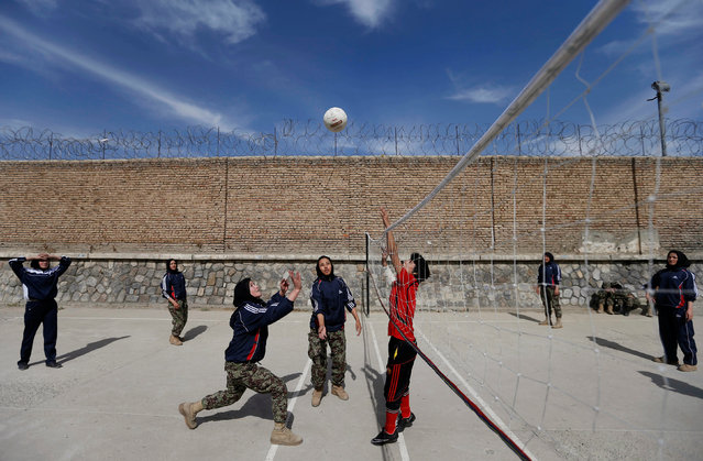 Female soldiers from the Afghan National Army (ANA) play volleyball at the Kabul Military Training Centre (KMTC) in Kabul, Afghanistan, October 23, 2016. (Photo by Mohammad Ismail/Reuters)