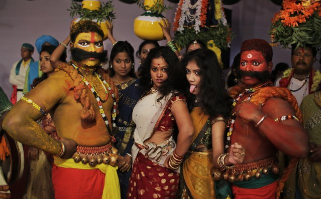 Artists from the state of Telangana react to the camera as they wait for their turn to perform during a media preview displaying a glimpse of culture of different parts of India, in New Delhi, India, Thursday, January 22, 2015. (Photo by Altaf Qadri/AP Photo)