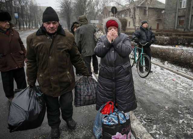 Local residents wait for a bus as they flee the conflict in Debaltseve, eastern Ukraine, February 6, 2015. (Photo by Gleb Garanich/Reuters)