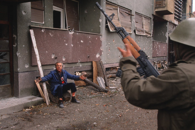 """1992 Visa d'or News: Christopher Morris. """"This is from my body of work on the break-up of Yugoslavia that was awarded the Visa d'or award for news in 1992. The image I've selected from the series is the day after the fall of Vukovar on November 18, 1991. (Photo by Christopher Morris)"""