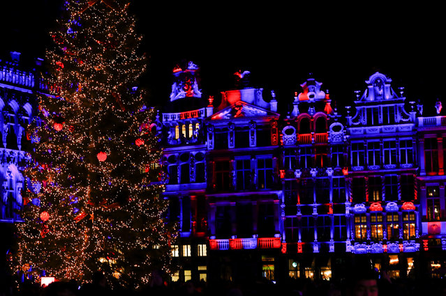 "Brussels' Grand Place is illuminated during a light show as part as the Christmas ""Winter Wonders"" (Plaisirs d'Hiver, Winter Pret) festivities, including a Christmas market and other events in central Brussels, Belgium, November 25, 2016. (Photo by Yves Herman/Reuters)"