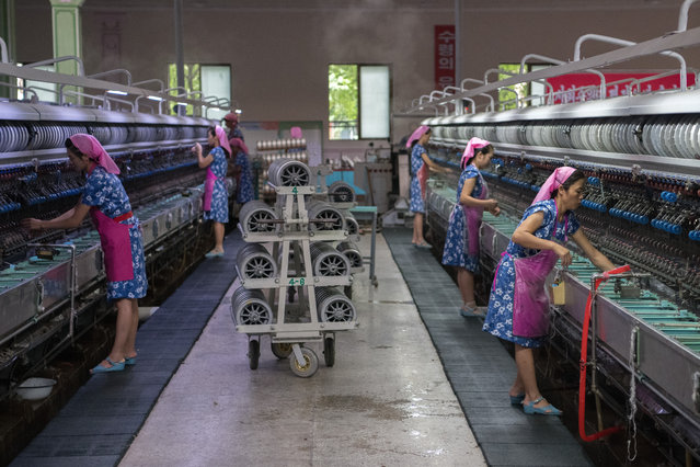 Women work in the Kim Jong Suk Silk Factory on August 21, 2018 in Pyongyang, North Korea. (Photo by Carl Court/Getty Images)
