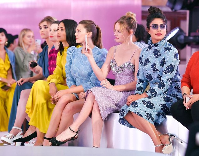 (R-L) Actresses Priyanka Chopra, Kate Bosworth and Elizabeth Olsen attend the Kate Spade fashion show during New York Fashion Week at New York Public Library on September 7, 2018 in New York City. (Photo by Angela Weiss/AFP Photo)
