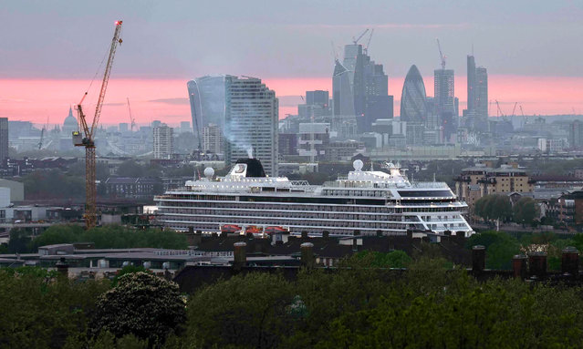 Cruise liner the Viking Sun is docked at Greenwich pier on the river Thames as the sun sets over St Paul's Cathedral and the City of London, England on May 4, 2018. (Photo by Claire Doherty/Sipa USA/Rex Features/Shutterstock)